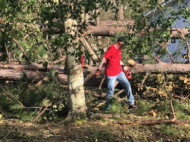 Removing debris after Hurricane Laura